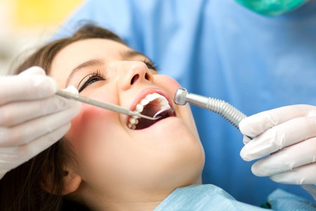 A dentist in Ahwatukee treats a woman with periodontal disease.